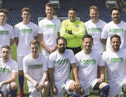 Covers Timber donates £5,000 to Portsmouth FC Academy following charity match